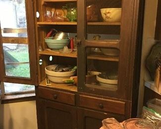 One of two Texas pie safes along with primitives, earthenware and early kitchen implements