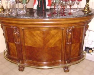 NICE SMALL , WALNUT , CURVED 1/2 BAR WITH BRASS FOOT RAILS--LIKE NEW--NO ABUSE!--NICE BLACK AND WHITE MARBLED TOP TOO WITH 2 TALL BAR STOOLS---ABOUT 6-7 FOOT LONG--NOT BIG !