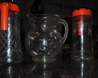 Tang pitchers and plastic Kool Aid man pitcher