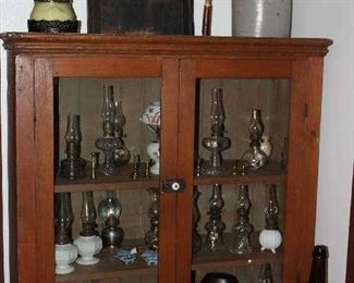"Antique Pine  Cabinet Top - Double Door Glass Front Jelly Cabinet (37"" H x 36""W x 13""D).   A display of Miniature Oil Lamps can be seen in the Interior."