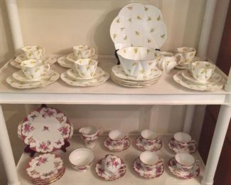English bone china cups & saucers, plates & more - top shelf is pre-Shelley Wileman Foley (pre-1910), lower shelf is Aynsley Wilton.
