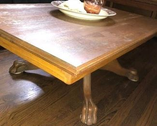 Oak rectangular claw footed coffee table.