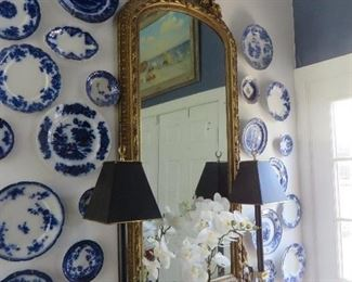 ANTIQUE FRENCH ROCOCO GILT MIRROR.  Surrounded by a selection of flow blue earthenware  / porcelain plates
