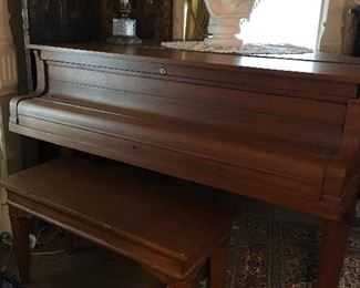 1900 Grand Prix  Baby Grand piano . Was purchased by a father for his daughter when she was a little girl. This piano had won several awards including an award at the 1904 ST Louis World Fair. My client bought later from lady and has owned it since. Taken several pictures for your convivence.