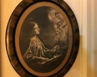 Antique picture of St. Cecilia playing piano with cherubs looking on
