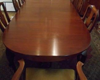 Hinkle-Harris dining room table. Wild cherry and includes eight chairs, two additional leaves and pads.