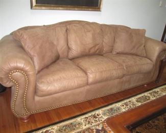 LEATHER SOFA AND MATCHING CHAIR AND OTTOMAN