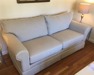 Sofa of Distinction by Klaussner - Purchased at Bernie & Phyls. White and grey stripe pillow ticking with white piping and dust skirt. Excellent condition - purchased with fabric protection). 84L x 40D x 31H