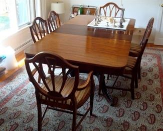 Vintage Duncan Phyfe  dining table and set of shield back chairs.