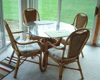 Rattan table & four chairs.