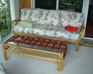 Rattan couch and coffee table.