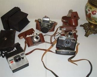 Collection antique cameras including, Regula, Exakta, Paxette, Optima, Koilos and others not shown.