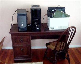 Desk, chair, & two Dell desk top computers.