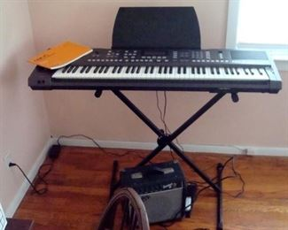 Roland EXR-7s syn. keyboard with fender amp, stand, and case.