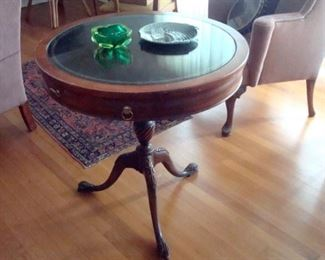 Vintage round leather top pedestal table.