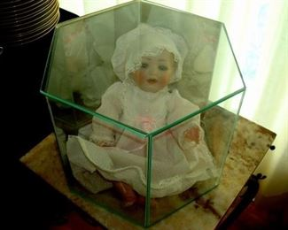 Doll in display case.