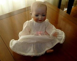Antique Character doll. Probably Kestner. Open mouth with two teeth and open close eyes, composition body.
