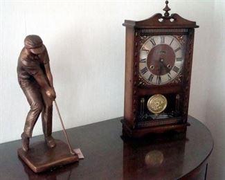 Centurion clock and bronzed plaster figurine.