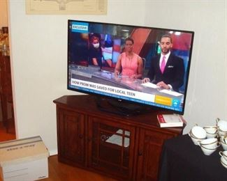 LG 50 inch smart 3-D HDTV with two pair 3-d glasses and cherry tv/component stand.
