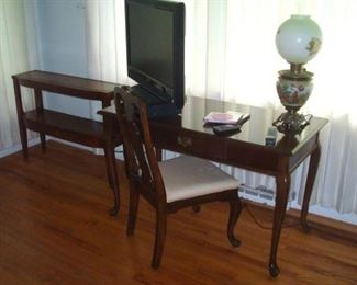 HDTV. , antique GWTW lamp with original base & shade, electrified. Queen Anne desk/table and vintage leather top sofa table.