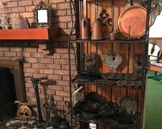 Cast Iron Items.  Skillets, Trivets, baking Pans, etc.                   Check the Basement for large pieces of Cast Iron.  (Pictures will be posted soon)