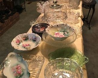 Prussia Bowls and Platters,  Cut Crystal.  Lots of Glass serving pieces, Cake Plates. (Check under the table also).
