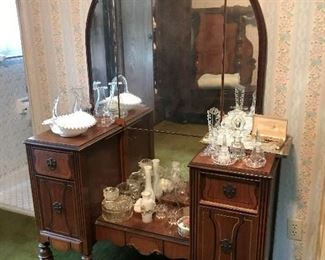 Dresser with matching chest of drawers and bed.      Perfume Bottles and dresser containers