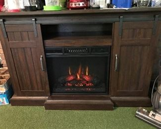 Electric Fireplace with sliding barn door style media cabinet.