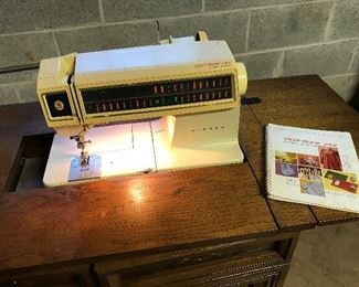 Singer model 2001 Sewing machine.  Zig Zag Nice cabinet