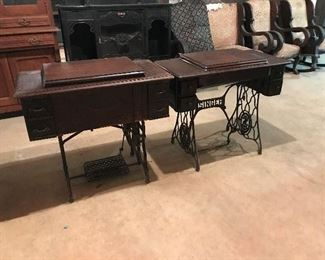 Old Singer Sewing machines and cabinets with iron base.  Great repurpose items