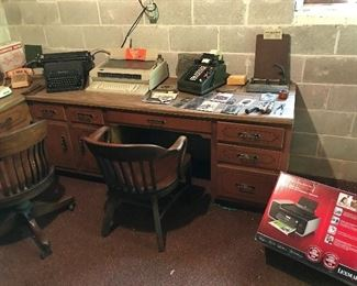 Old Desks, Old Desk Chairs,  Old office equipment, Typewriters.  Adding Machines, etc.