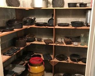 Cast Iron Skillets, baking pans, dutch oven.  Large cauldrons are not in the photo.