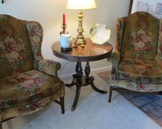 PAIR OF WING CHAIRS WITH CIRCULAR MANOGANY TABLE