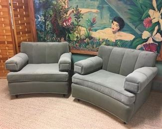 Pair of 1950s club chairs, professionally upholstered in a soft sage green fabric