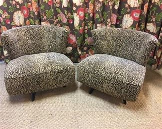 Pair of 1950s slipper chairs with black lacquer legs, professionally upholstered in a soft leopard print fabric