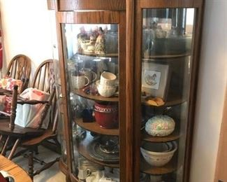 Beautiful antique curved glass, claw feet, Curio cabinet