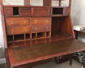 Stickley desk open reveals leather inset and storage drawer & cubbies.