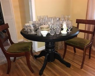Contemporary round pedestal table, chairs.