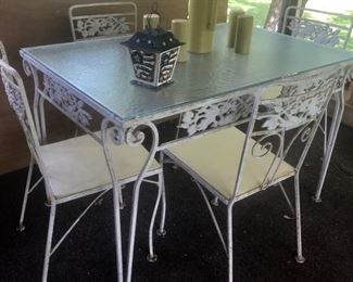 Vintage decorative iron patio furniture--4 chairs to use separately or join together to make settee, dining table and 4 chairs, and rectangular coffee table.