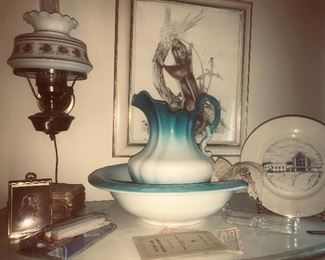 Assorted decor--lamps, wall art, glassware and pottery.