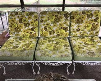 Vintage 5-piece decorative iron patio furniture: 3 chairs make a settee when used together, one rocking chair and one glass top coffee table—priced as set.