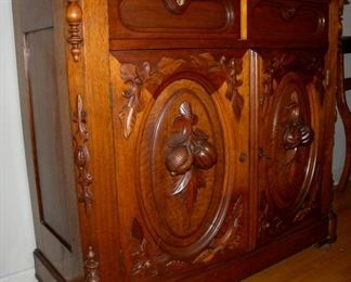 Jacobean carved side cabinet with white marble top.  Antique. (2 available)