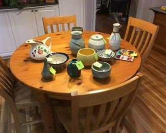 Kitchen table with Art pottery