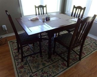 Nice Vintage Breakfast set. Table and four chairs.     The Floor Rug is for sale also!!