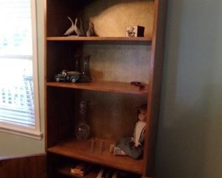 Matching the Secretary, the Shelving unit has cabinet doors on the bottom