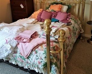Double Brass Bed,  crocheted & fabric tablecloths & bed linens