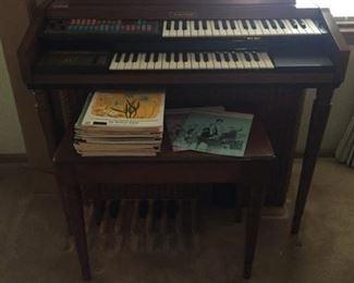 Wurlitzer small organ, lots of music books