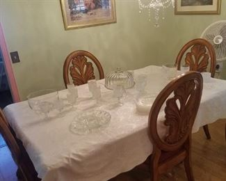 Dining table and 4 chairs with leaves..top as is $195.00