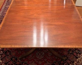 Beautiful Ducan Phyfe style table.  The top is as good as it looks in real life as it does here...