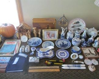 Many pieces of delft pottery